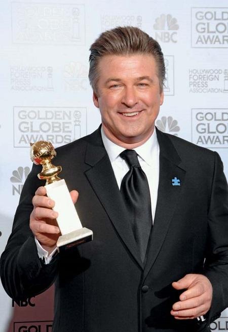 American actor, Alec Baldwin winning a Golden Globe Award