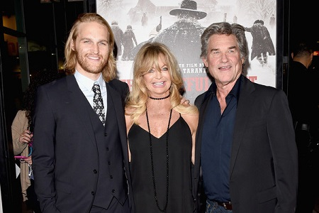 Kurt Russell with his partner Goldie Hawn and their son Wyatt Russell at the premiere of The Hateful Eight