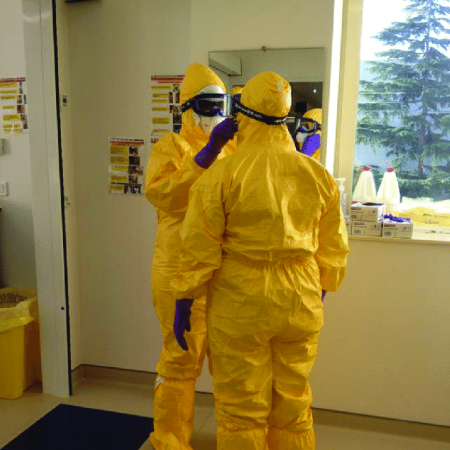 Health officials using PPE as they tackle an overwhelmed health system