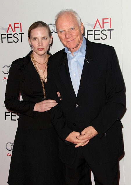 Malcolm with his wife, Kelley Kuhr
