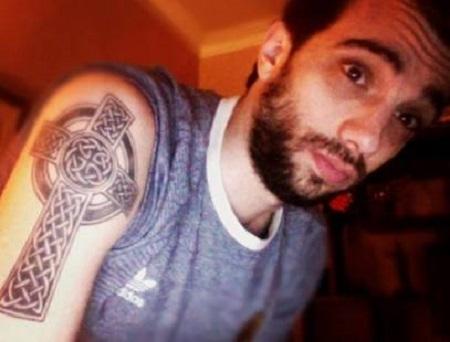 Jay Baruchel's Celtic cross tattoo